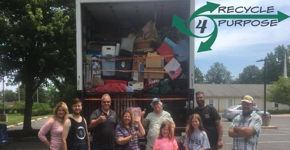 Thrift store team infront of moving truck